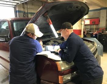 Automotive technician students work on a truck