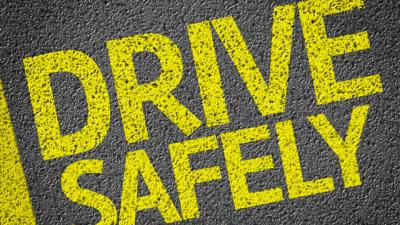 Image of the words drive and safely painted on the street