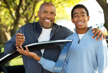 father and son by vehicle with keys