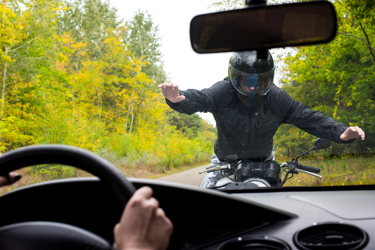 Vehicle hitting motorcyclist