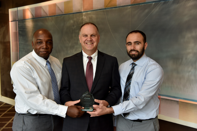 DRE Award - ITSMR Senior Programmer Analyst Jamal Goddard, GTSC Assistant Commissioner Chuck DeWeese and ITSMR Programmer Analyst Joe Barra, who accepted the award.